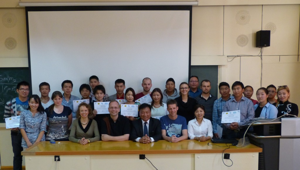 Teachers and participants at the school, after the students received their certificates of achievement and attendance