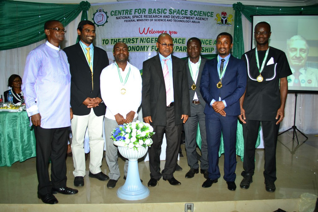 from  left: Bonaventure Okere (Regional Coordinator for the West African Regional Office of Astronomy for Development, Nigeria), Kevin Govender (Director of the IAU Office of Astronomy for Development, South Africa), Zaka K. Zacharie (Country Coordinator for Ivory Coast), Fidelix Opara (Director of the Centre for Basic Space Science in Nigeria), Kam Sie Zacharie (Country Coordinator for Burkina Faso), Eric Aggrey (Country Coordinator for Ghana), Patrice Okouma (Country Coordinator for Gabon) and Piero Benvenuti joining by video in the background (IAU General Secretary). credits: IAU/ Dele from the Centre for Basic Space Science, Nigeria