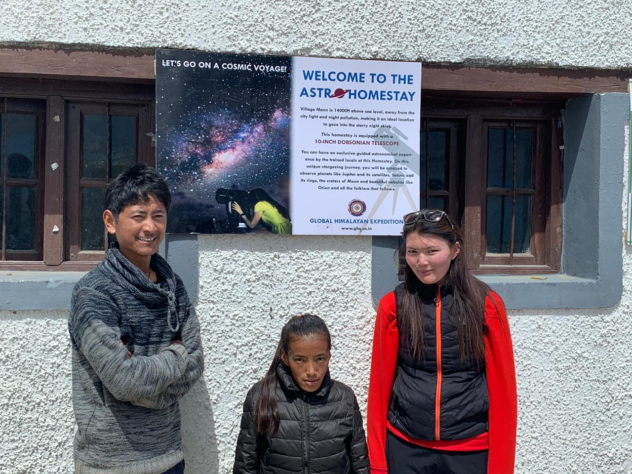 in front of the home with sign for stargazing