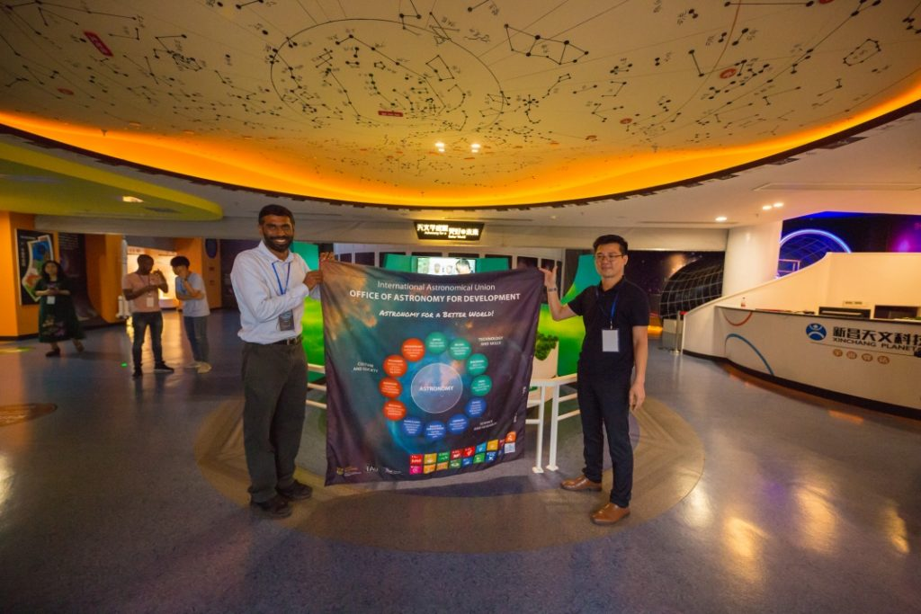 OAD director Kevin Govender handing the OAD banner to Xinchang Planetarium