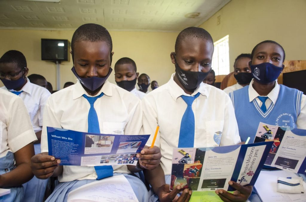 Schoolgirls at St Peters Girls School read about EMEJA and the support that the project is offering them to stay in education
